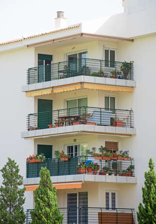 timeshare: Portrait of tropical apartment building with balconies. Stock Photo