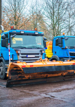 Road services are ready for winter. Winter service vehicles. photo