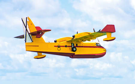 amphibious: Aerial firefighting.  Aircraft preparing to collect sea water.