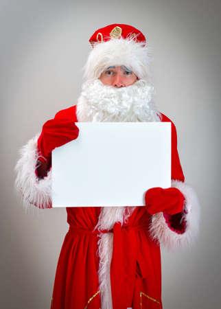 pathetic: Pathetic Santa Claus is holding white blank.