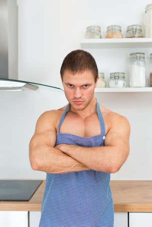 Man wearing apron in the kitchen. photo