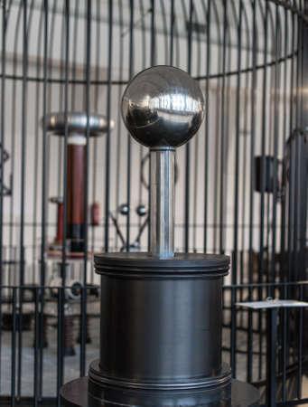 Resonant transformer in faraday cage. Tesla coil.
