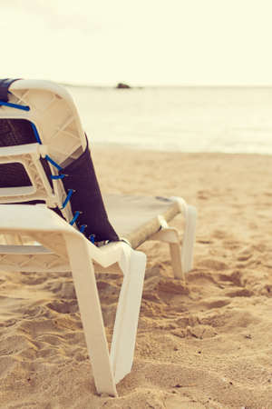 lounger: Empty lounger on the beach. Stock Photo