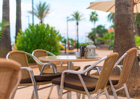 Mediterranean cafe terrace exterior with chairs. photo