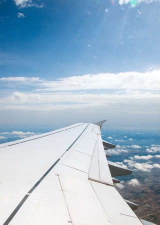 window view: Wing of an airplane, view from window.