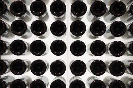Many wine bottles. Bottom view. photo