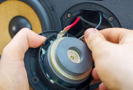 hi fi: Male hand connecting professional studio monitor speaker. Stock Photo