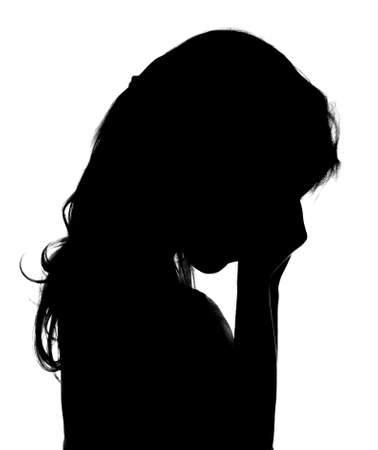 Silhouette of crying little girl. Imagens