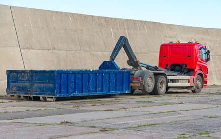 Red truck with a removable container.