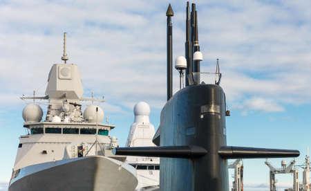Naval fleet. Submarine and warships with guns. Reklamní fotografie