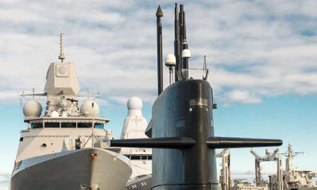 naval: Naval fleet. Submarine and warships with guns. Stock Photo