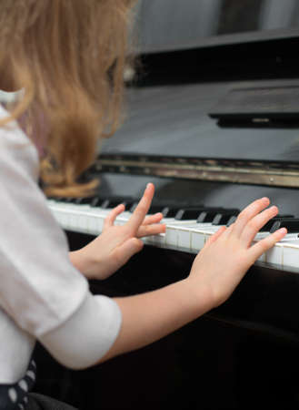Child learns to play the piano. photo