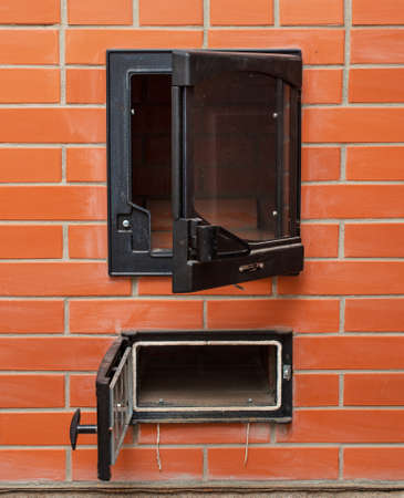 woodburning: Open red brick oven with ashtray.