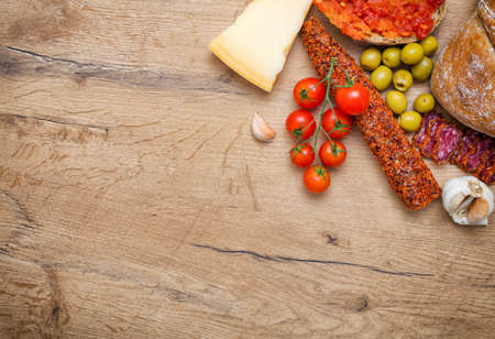 tomato paste: Bruschetta with tomato paste tomatoes cheese olives garlic and fuet. Place for text.