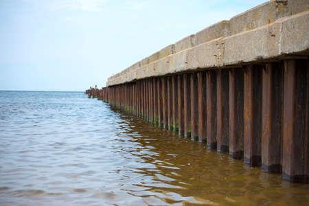 old pier: Broken old pier in open sea.