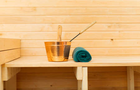 finnish bath: Metal bucket and towel in sauna. Place for text.