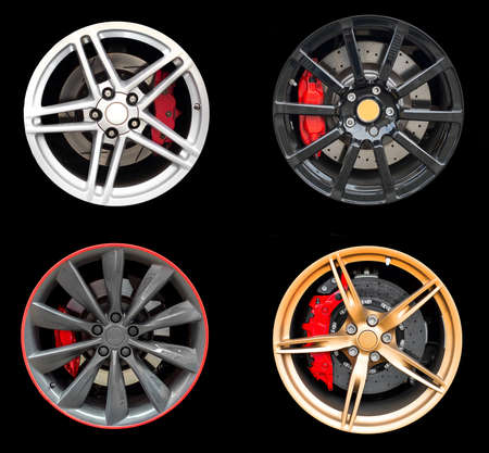 rims: Collage of Four car rims isolated on black background. Stock Photo