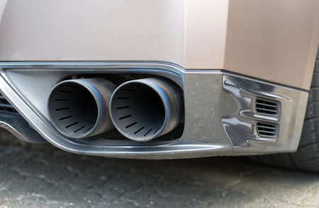 exhaust pipe: Double exhaust pipe. Part of sports car.