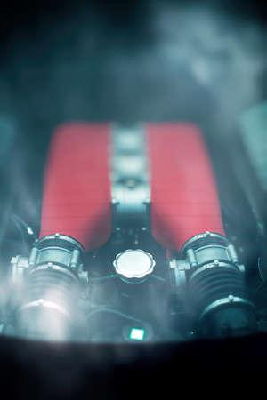injection valve: Sports car engine under rear glass trunk.