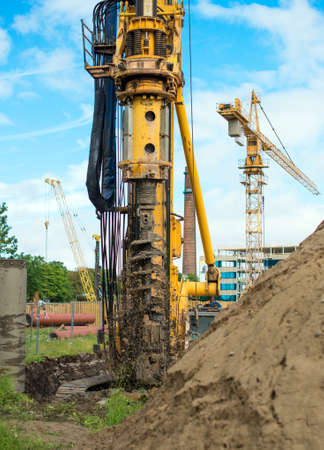 dug well: Hydraulic drilling machine on the construction site.