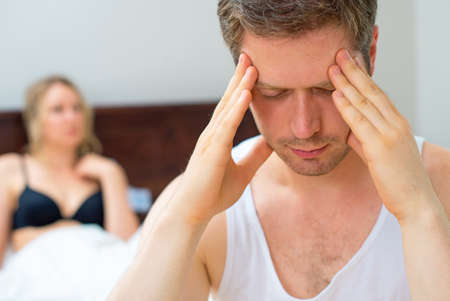 man and woman sex: Расстроенная молодая пара, проблемы с сексом. Фото со стока