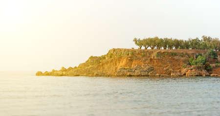 uninhabited: Beautiful uninhabited sunny island with trees. Stock Photo