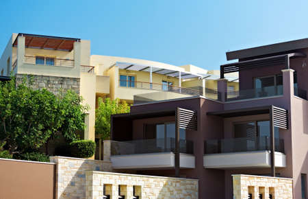 contemporary house: Two tropical apartment buildings with balconies.