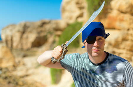 pirate captain: Male pirate with sword. Place for your text. Stock Photo