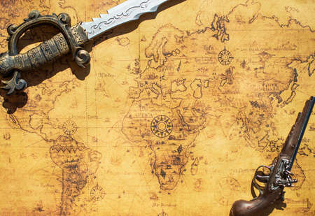 musket: Old treasure map with sword and musket gun.