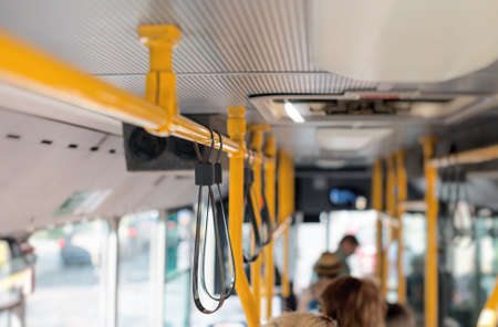 motorbus: View from inside the city bus with passengers.