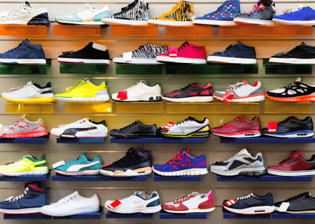 Big collection of different sport shoes. Stock Photo