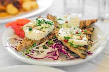 haloumi: Fried Halloumi cheese with roasted bread.