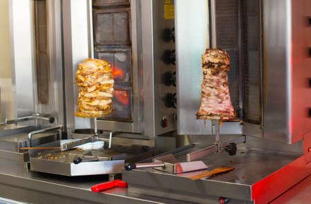 greek chef: Pita gyros preparation on the kitchen in street cafe. Stock Photo