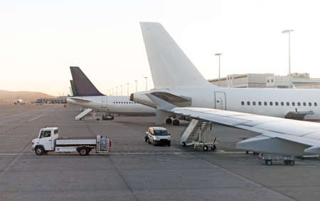 cleaning supplies: Passenger plane in the airport. Aircraft maintenance. Editorial