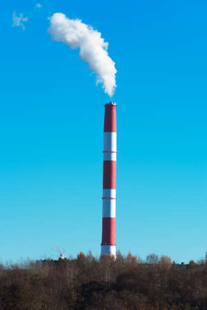 smog: Air pollution. Dirty smog from big factory chimney. Stock Photo