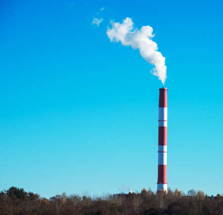 CO2 emissions: Air pollution. Dirty smog from big factory chimney. Stock Photo