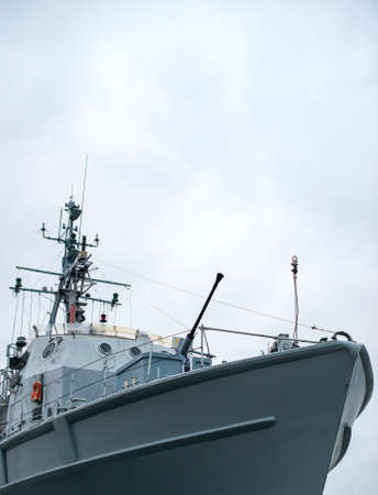 gun: Patrol ship with radar and gun. Stock Photo
