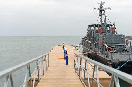 patrol officer: Coast Guard vessel docked in the port.