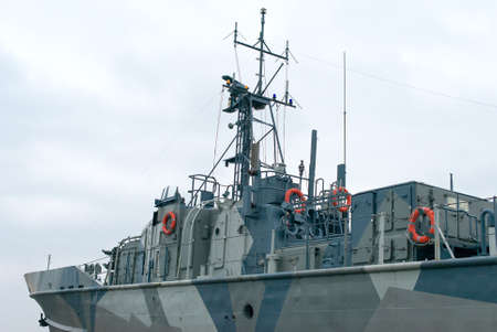 Naval ship with radar and gun.
