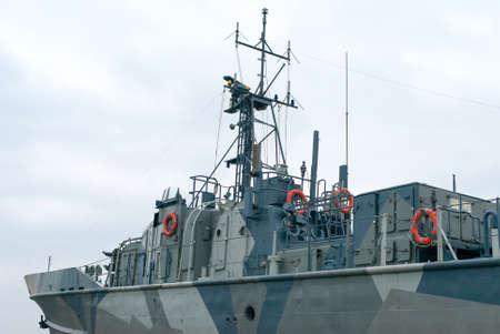 coastguard: Naval ship with radar and gun.