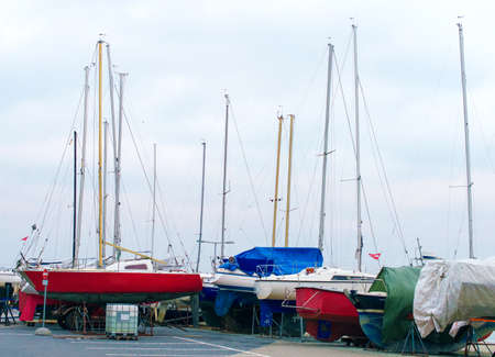 drydock: Yachts parked on the beach in the off-season.