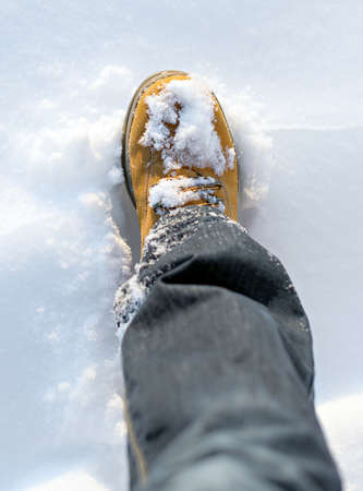 hillwalking: Mens boot in the snow in winter.