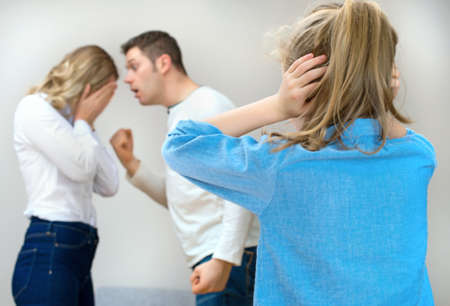 squabble: Parents quarreling at home, child in shock.