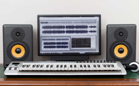 making music: Home recording studio with professional monitors and midi keyboard.