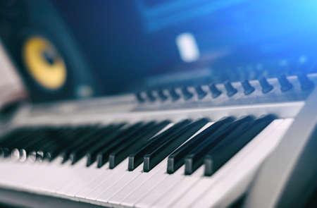 Midi keyboard. Home recording studio with professional monitors.