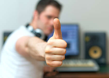 producer: Male sound producer with thumbs up.
