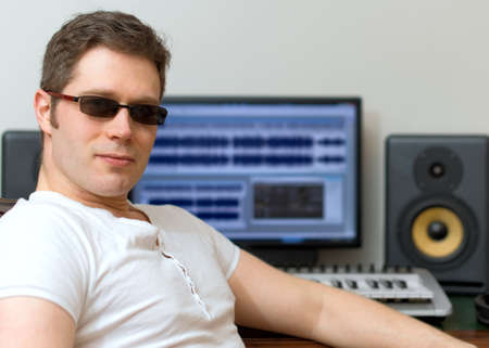 remix: Male sound producer in recording studio.