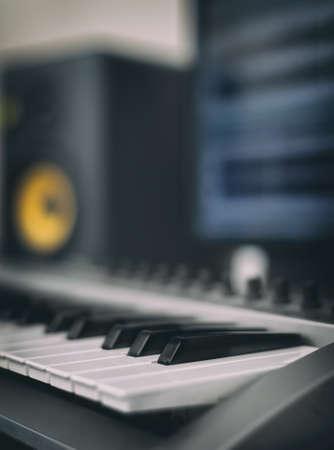 remix: Midi keyboard. Home recording studio with professional monitors.