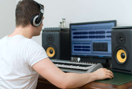 Male sound producer working in recording studio.