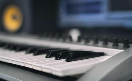 recording studio: Midi keyboard. Home recording studio with professional monitors.